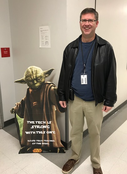 Jason Anderson poses with Yoda as Tech Teacher of the Week