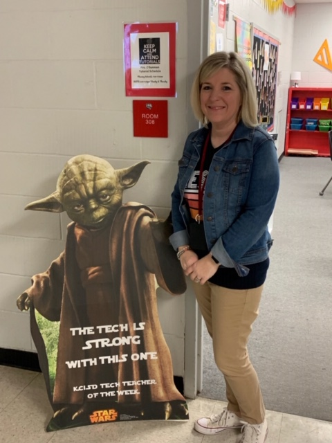 Kelley O'Bannion poses with Yoda as the Tech Teacher of the Week