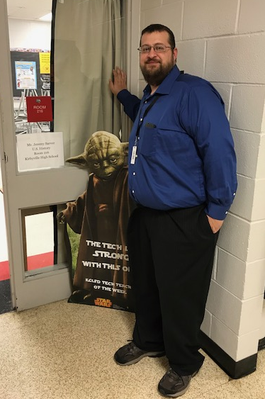 Jeremy Sarver poses with Yoda as Tech Tearcher of the Week