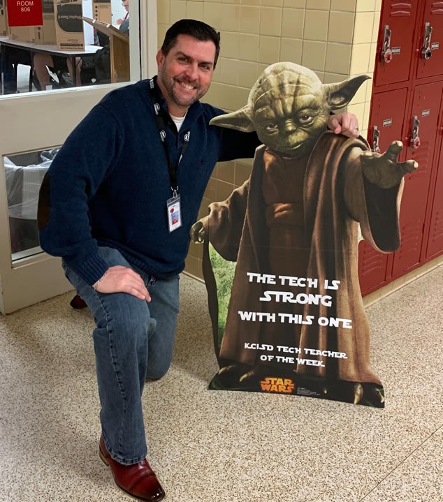 Kenneth VIncent poses with Yoda as Tech Tearcher of the Week